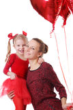 Daughter and mother with red balloons Stock Photo