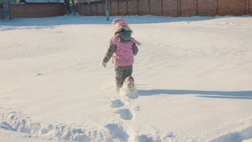 Daughter and mother run around in the snow. stock footage