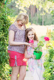 Daughter with  mother in the summer garden Royalty Free Stock Image