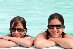 Daughter and mother in a swimming pool Royalty Free Stock Photo