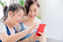 Daughter and mother use smartphone royalty free stock photo