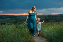 Daughter and mother walking outdoors Royalty Free Stock Photos