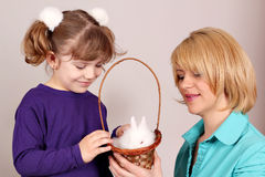 Daughter and mother with white bunny pet Royalty Free Stock Images