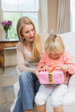 Daughter opening a present from mum Royalty Free Stock Photography