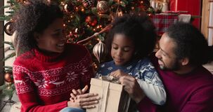 Daughter opens gift box prepared parents with love for Christmas