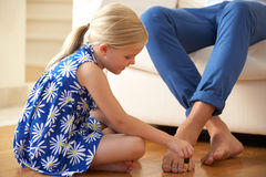 Daughter Painting Father's Toenails At Home Stock Photos
