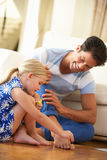 Daughter Painting Father's Toenails At Home Royalty Free Stock Images