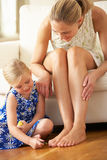Daughter Painting Mother's Toenails At Home Stock Image