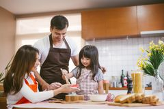 Daughter and parent preparing the bake. Daughter and parent preparing the bake royalty free stock images