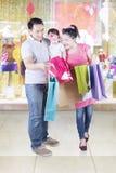 Daughter and parents looking at shopping bag Royalty Free Stock Image