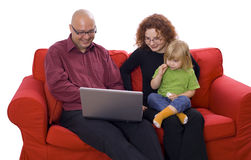 Daughter and parents playing with a laptop Royalty Free Stock Images