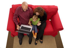 Daughter and parents playing with laptop Royalty Free Stock Photos