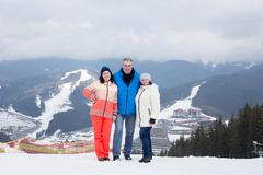 Daughter with parents at the top of the mountain. Royalty Free Stock Photos