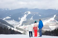 Daughter with parents at the top of the mountain. Stock Images