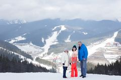 Daughter with parents at the top of the mountain. Stock Photography