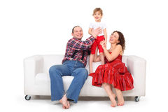 Daughter and parents on white leather sofa Royalty Free Stock Photos