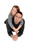 Daughter piggyback on dad. Stock Photos