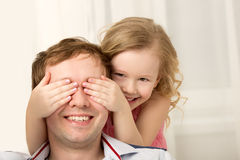 Daughter playing with father closing his eyes Royalty Free Stock Photography