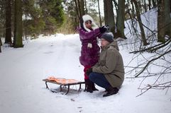 Daughter playing with father in winter Royalty Free Stock Photos
