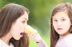 Daughter poked mother with ice cream in her face. Stock Image