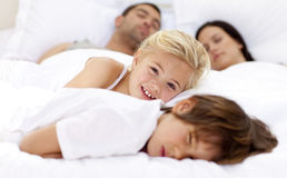Daughter relaxing with her brother and parents Royalty Free Stock Photos