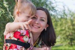 Daughter reveals something  finger Stock Image
