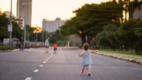 daughter run following mom and brother royalty free stock photo