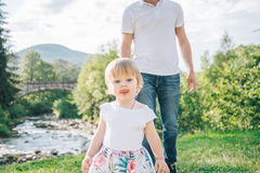 Daughter run to father`s hug Stock Photography