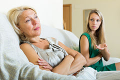 Daughter  and  sad mature mother having conflict Royalty Free Stock Image