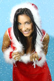 The daughter of santa claus is sexy. Girl dressed santa claus reveals her breast Royalty Free Stock Photos
