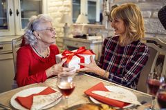 Daughter and senior mother m together celebrate Christmas at hom stock photography