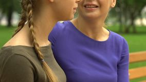 Daughter shares secret with loving mom, trust-based warm relations in family. Stock footage stock footage