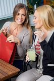 Daughter Showing Purchases To Mother At Cafe Stock Images