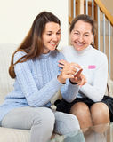 Daughter shows her happy mother pregnancy test Stock Images