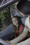 Daughter sitting in car with her mother Royalty Free Stock Photo