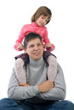 Daughter sitting on daddy's shoulders Stock Photography
