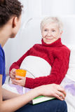 Daughter spending time with elderly mother stock photo