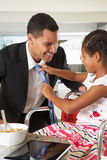 Daughter Straightens Father's Tie Before He Leaves For Work Royalty Free Stock Photography