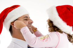 Daughter stretching father's cheeks Royalty Free Stock Photos