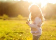 Daughter at sunset playing stock photos