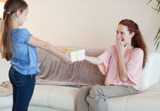 Daughter surprises her mother with a gift Royalty Free Stock Photos