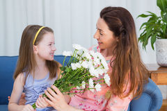 Daughter surprising mother with flowers Stock Photography
