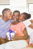 Daughter surprising mother with a present Stock Photography
