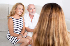 Daughter talking with parents. Elderly daughter visiting her parents stock photography