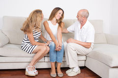 Daughter talking with parents. Elderly daughter visiting her parents royalty free stock image