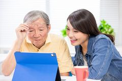 Daughter teach father use tablet royalty free stock photo
