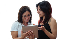 Daughter teaches mother. How to use the tablet Stock Image