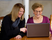 Daughter teaching elderly mother Stock Photo