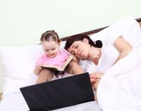 Daughter to read only after his mother fell asleep stock image