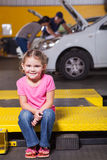 Daughter waiting garage Royalty Free Stock Photography